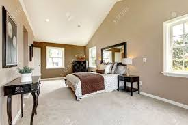 Large Classic Luxury Bedroom With Brown And White And Beige Carpet ...