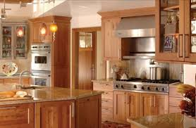 Light Colored Wood Kitchen Cabinets With Kashmir Gold Granite For The  Countertops Below Plastic Handle Bread