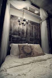 mysterious bedroom decorating ideas with old wooden doors headboard and white curtain canopy featuring ancient candelabra of incredible bed headboards ideas
