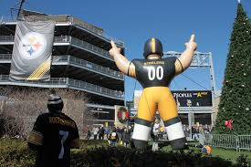 a giant inflatable steeler towers over the crowds filing into heinz field for a home