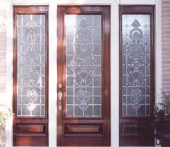 custom entry with intricate designs in door and side light windows