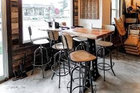Industrial styled coffee shop with wood walls, metal and wood furniture -  HazelSprings Organic Bakery