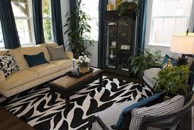 matching rug and pillows the black and white patterned rug sets the dramatic design foundation for