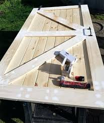 this tutorial on how to make a simple barn door is so easy i love build with glass insert