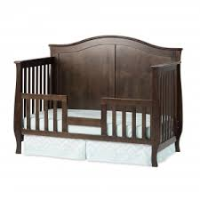 Converts to a toddler bed with toddler guard rail F09514 sold separately