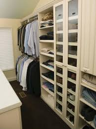 walk in man s closet with shoe shelf