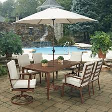home styles key west chocolate brown 9 piece extruded aluminum outdoor dining set with beige