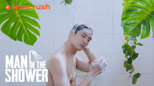 Young asian taking shower video streaming