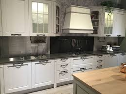 kitchen frosted glass cabinets door white island with wooden countertop copper pots black backsplash stainless