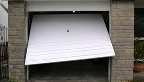 broken garage doorGarage Door Repair Milwaukie