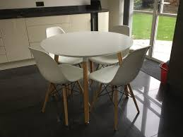 modern white dining table and  bucket chairs  in st ives