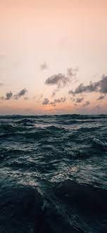 sea under cloudy sky in nature ...