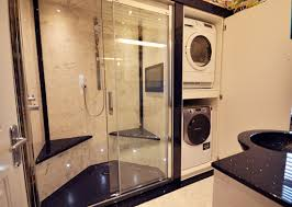 black and white style bathroom featuring versital resin shower panels vanity top and bespoke shower