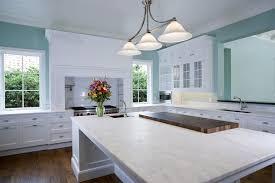 open space kitchen with white quartz countertops