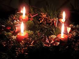a traditional advent wreath with four candles burning photo wikimedia commons
