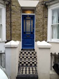 hand made period front door fitted with stained glass front steps and path leveled and re tiled in victorian style