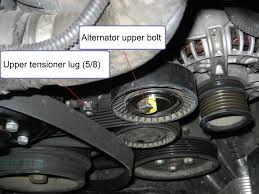 x5 3 0 alternator and belts diy pictures xoutpost com i removed the alternator pulley side up straight up and out of the engine bay via the front of the engine the cardboard kept my radiator unscathed so use