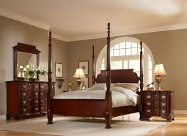 dark mahogany furniture. Mahogany Bedroom Furniture Four Mast Brown Color Dresser With Mirror White Carpet Chandelier Blanket Pillows Simple Dark