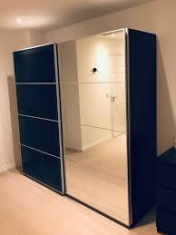 large ikea wardrobe black brown wood effect mirror and glass sliding doors 2 meters wide