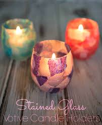 make faux stained glass candle holders for the holidays with this easy tissue paper craft