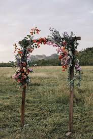 simple wooden fl arch for your wedding ceremony