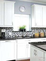 a pop of purple adds subtle color to this gray glass tile kitchen decorating ideas with dark cabinets best colors on paint remodeling