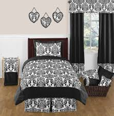 spanish bedroom idea with black and white damask decor on sheet and pillows