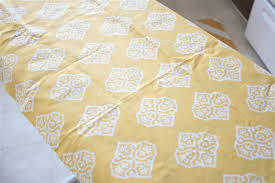 once everything was nice and flat i broke out my heat n bond no sew hemming tape this stuff is so easy to use and has reduced my stress ten fold when