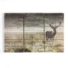 on debenhams wall art canvases with graham brown green highland stag print on wood wall art debenhams
