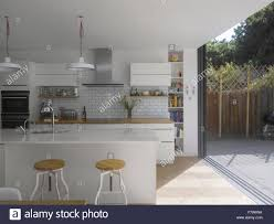 Kitchen And Garden Kitchen And With Sliding Door To Garden In Uk Home Stock Photo