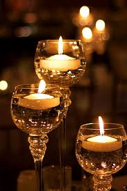 Floating candles in glass goblets.