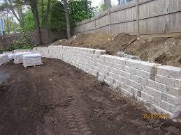 unilock retaining wall img 1758 jpg become a part of our family team