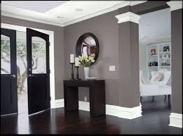 Simple Dark Hardwood Floors Living Room With The Grey Walls And White Crown Molding On Decorating Ideas