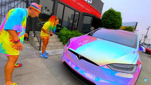 Jojo siwa rocks one of her signature bows during a few appearances in new york city on wednesday (august 2). Tesla Owner Graffitis Own Car For Bizarre Unicorn Wrap