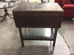 lot 51 vintage drop leaf side wooden tea cart w castors fair cond