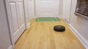 a looped video shows a robot vacuum ping and zig zagging around a small hardwood