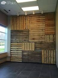 this pallet wood walls design is made by using complete pallets hung in various directions