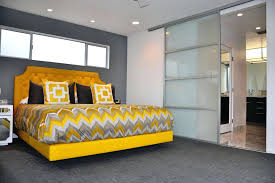 bedroom with sliding glass doors solar shades for contemporary bed