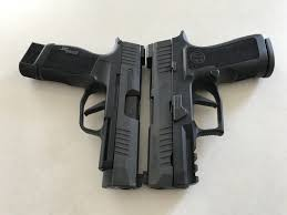 Sig P365 With Light Sig Faceoff Sig P365 Vs X Compact Vs P365 Xlthe Firearm Blog