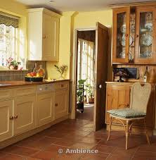 yellow country kitchens.  Country Terracotta Floor Tile Kitchen  Tiles In Yellow Country  With Cane Chair  To Yellow Country Kitchens