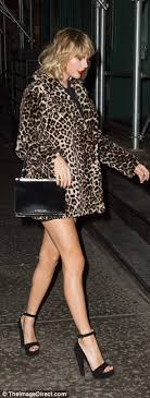 Small Picture Taylor Swift takes a walk on the wild side in a leopard print coat