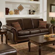 living room leather furniture ideas. a sleek brown leather sofa with accent pillows. when paired dark wooden tables, living room furniture ideas o