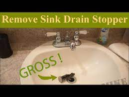 removing a sink drain stopper to unclog