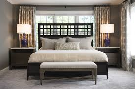 master bedroom design king bed in front of window with wooden headboard