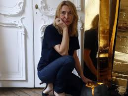 french lighting designers. french lighting designer odile soudant poses next to her creations in studio paris designers e