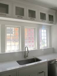 sink windows window love: i love the little square cabinets above the window perfect for storing the pretty plates and bowls
