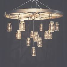 best 25 wagon wheel light ideas on intended for within wagon wheel chandelier