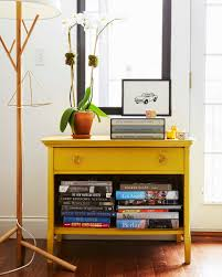 our brooklyn apartment a cup of jo years ago we got this trusty vintage console and our genius friend jenny komenda spray painted it yellow it s such a great example of how paint can