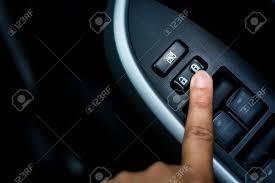 car door lock button. Finger Push Lock Button Of Car Doors. Stock Photo - 85262020 Door T
