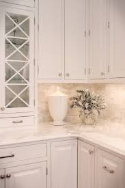 calacatta marble kitchen waterfall: calcutta gold marble in five kitchens we love